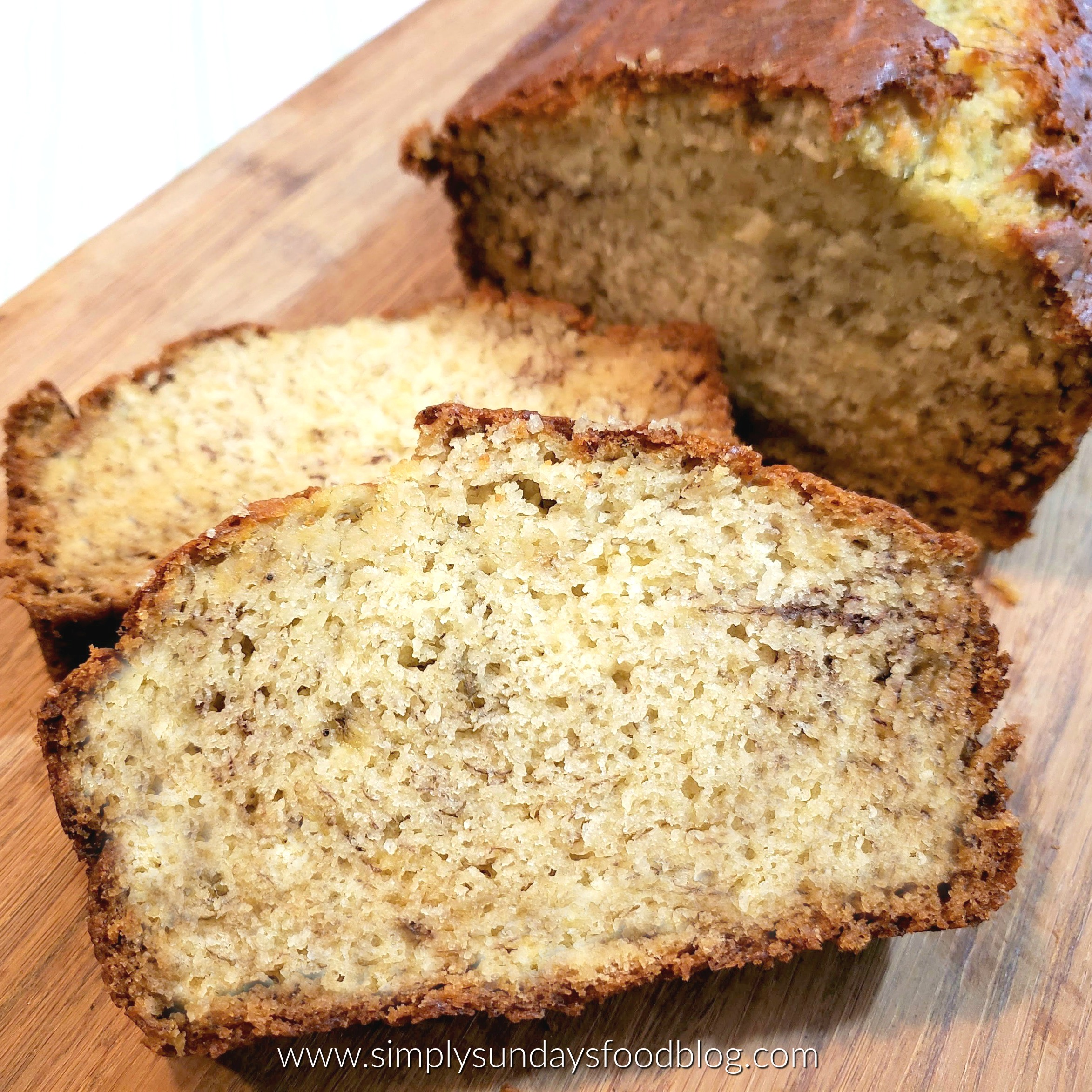 Slices of moist banana bread on a cutting board